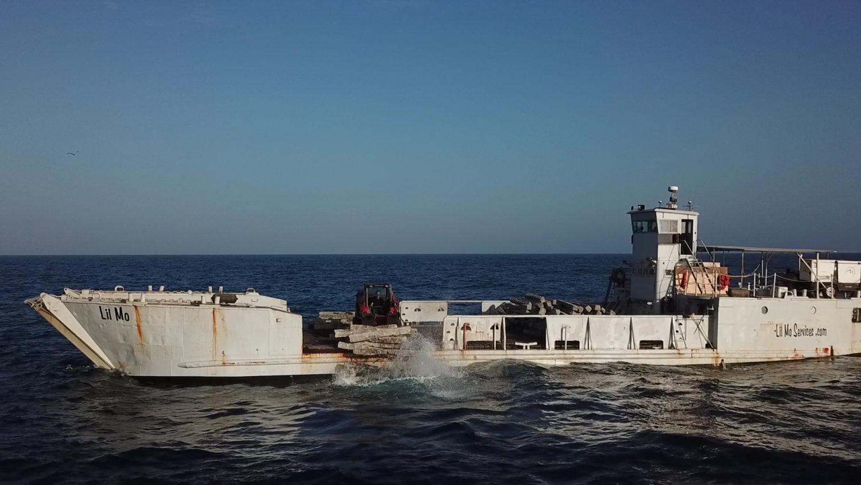 dumping concrete blocks to build the RGV Reef
